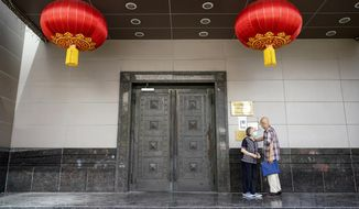 Visitors try to enter the Chinese Consulate General Wednesday, July 22, 2020, in Houston. China says the U.S. has ordered it to close its consulate in Houston in what it called a provocation that violates international law. (AP Photo/David J. Phillip)