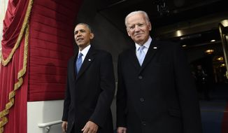 In this Jan. 20, 2017, file photo, President Barack Obama and Vice President Joe Biden arrive for the Presidential Inauguration of Donald Trump at the U.S. Capitol in Washington. (Saul Loeb/Pool Photo via AP, File)