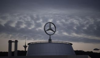 The Mercedes star is pictured at the Mercedes Benz headquarters in Stuttgart, Germany, Wednesday, July 8, 2020. Due to the Corona pandemic, the annual general meeting of the car manufacturer Daimler takes place only online. (Marijan Murat/dpa via AP)