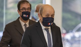French Foreign Minister Jean-Yves Le Drian, wearing a mask to help prevent the spread of the coronavirus, arrives to meet Lebanese president Michel Aoun at the Presidential Palace in Baabda, east of Beirut, Lebanon, Thursday, July 23, 2020. (AP Photo/Hassan Ammar)