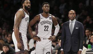 FILE - In this March 8, 2020, file photo, Brooklyn Nets interim head coach Jacque Vaughn, right, talks with Caris LeVert, center, and DeAndre Jordan during the second half of an NBA basketball game against the Chicago Bulls at the Barclays Center in New York. The Nets have a depleted roster as they prepare for the resumption of the NBA season. But despite missing many of their core players, they still have a good chance to make the playoffs in the Eastern Conference. (AP Photo/Seth Wenig, File)