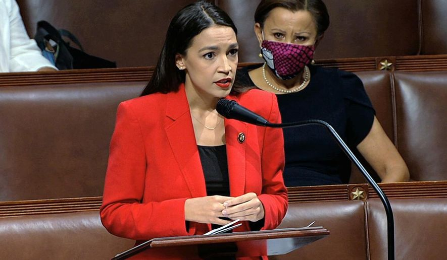 """In this image from video, Rep. Alexandria Ocasio-Cortez, D-N.Y., speaks on the House floor, Thursday, July 23, 2020 on Capitol Hill in Washington.   Ocasio-Cortez's objections to a Republican lawmaker's verbal assault on her expanded Thursday as she and other Democrats took to the House floor to demand an end to a sexist culture of """"accepting violence and violent language against women.""""  Rep. Nydia Velázquez, D-N.Y., is seated right. (House Television via AP)"""