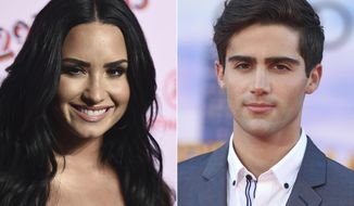 """This combination photo shows Demi Lovato arrives at the West Coast debut of 29rooms at ROW DTLA in Los Angeles on Dec. 6, 2017, left, and actor-singer and Max Ehrich arrives at the Los Angeles premiere of """"Spider-Man: Homecoming"""" in Los Angeles on June 28, 2017. The couple made their engagement announcement on Instagram on Thursday, both posting a photo of themselves kissing on the beach. Lovato also posted a picture of her new ring. (Photo by Jordan Strauss/Invision/AP)"""
