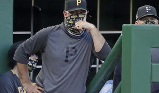 FILE - In this July 22, 2020, file photo, Pittsburgh Pirates manager Derek Shelton stands on the dugout steps during an exhibition baseball game against the Cleveland Indians in Pittsburgh. The Pirates first-year manager is a mix of old-school grit and new-school analytics nerd. The club also believes he's a breath of fresh air for a franchise in need of a jolt. (AP Photo/Gene J. Puskar, File)
