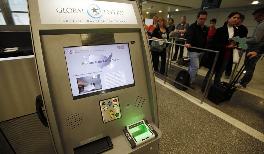 FILE - In this May 28, 2010, file photo, a Global Entry Trusted Traveler Network kiosk awaits arriving international passengers who are registered for the service at the Tom Bradley International Terminal at Los Angeles International Airport. On Thursday, July 23, 2020, the Department of Homeland Security announced that New Yorkers would once again be allowed to enroll and re-enroll in Global Entry and other federal travel programs that allow vetted travelers to avoid long security lines at the U.S. border. (AP Photo/Reed Saxon, File)