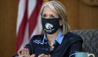New Mexico Gov. Michelle Lujan Grisham gives her weekly update on COVID-19 and the state's effort to contain it during a virtual news conference from the state Capitol in Santa Fe, N.M., on Thursday, July 23, 2020. (Eddie Moore/The Albuquerque Journal via AP)