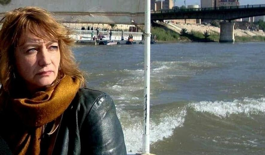CAPTION ADDITION ADDS SOURCE OF PHOTO - In this undated photo provided by Tower of Babel for Media Development, German national, Hella Mewis rides on a boat on the Tigris River, in Baghdad, Iraq. An Iraqi security official and human rights monitors said Tuesday, July 21, 2020, that Mewis was kidnapped Monday night in Baghdad outside the arts center where she works. The official said that Mewis was taken by armed men in two vehicles, citing ongoing investigations. She was well known in Iraq's art scene and an ardent supporter of mass anti-government protests. (Tower of Babel for Media Development via AP)