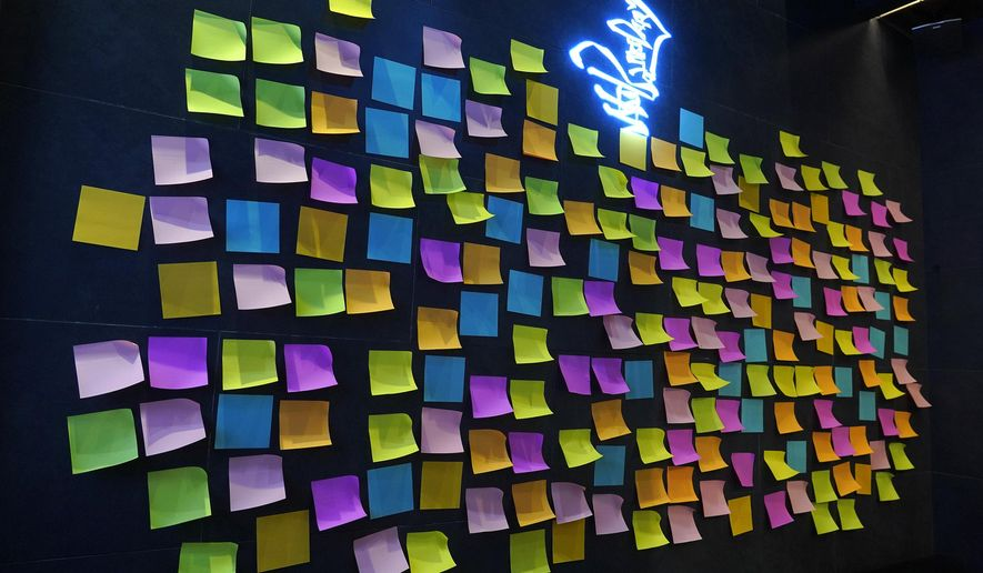 In this file photo, a Hong Kong Cafe, known as a 'yellow shop' because its owners expressed sympathy for protesters, has a wall decorated with blank post-it notes in Hong Kong Thursday, July 9, 2020. (AP Photo/Vincent Yu)  **FILE**