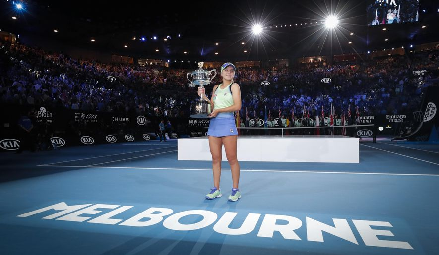 "FILE - In this Feb. 1, 2020, file photo, Sofia Kenin of the U.S. holds the Daphne Akhurst Memorial Cup after defeating Spain's Garbine Muguruza in the women's singles final at the Australian Open tennis championship in Melbourne, Australia. Tennis Australia chief executive Craig Tiley will be looking at the delayed running of both the U.S. Open and French Open to help plan contingencies for the first Grand Slam tournament of 2021, but Tiley says the tournament has already decided on how the Australian Open will shape up in January, reduced seating due to social distancing, players in a secure biosecurity ""bubble"" and the likelihood of no overseas spectators. (AP Photo/Lee Jin-man, File)"