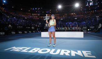"""FILE - In this Feb. 1, 2020, file photo, Sofia Kenin of the U.S. holds the Daphne Akhurst Memorial Cup after defeating Spain's Garbine Muguruza in the women's singles final at the Australian Open tennis championship in Melbourne, Australia. Tennis Australia chief executive Craig Tiley will be looking at the delayed running of both the U.S. Open and French Open to help plan contingencies for the first Grand Slam tournament of 2021, but Tiley says the tournament has already decided on how the Australian Open will shape up in January, reduced seating due to social distancing, players in a secure biosecurity """"bubble"""" and the likelihood of no overseas spectators. (AP Photo/Lee Jin-man, File)"""