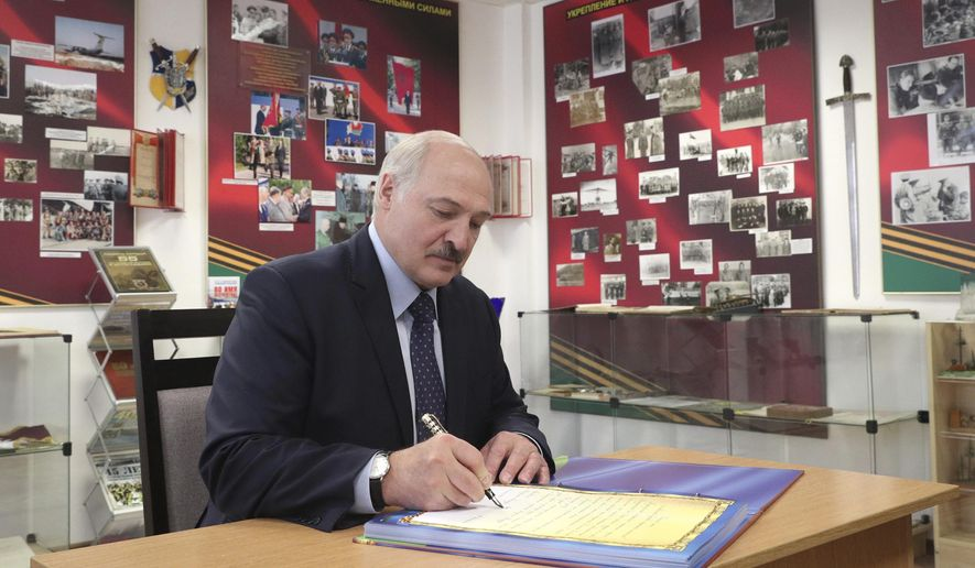 """Belarusian President Alexander Lukashenko writes review as he his visits the military base in the town of Maryina Gorka, 60 kilometers (37 miles) southeast of Minsk, Belarus, Friday, July 24, 2020. Lukashenko warned Thursday that Western media could be expelled from the country over what he described as their """"tendentious"""" coverage of the presidential election next month in which he is seeking a sixth term. The presidential election in Belarus is scheduled for August 9, 2020. (Nikolai Petrov/BelTA Pool Photo via AP)"""
