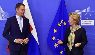 European Commission President Ursula von der Leyen, right, welcomes Slovakia's Prime Minister Igor Matovic prior to a meeting at the European Council building in Brussels, Thursday, July 16, 2020. (John Thys, Pool Photo via AP)