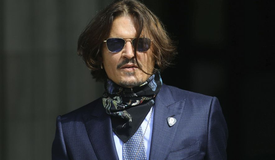 """Actor Johnny Depp arrives at the High Court for a hearing in his libel case, in London, Friday,  July 24, 2020. Depp is suing News Group Newspapers, publisher of The Sun, and the paper's executive editor, Dan Wootton, over an April 2018 article that called him a """"wife-beater."""" The Sun's defense relies on a total of 14 allegations by his ex-wife, actress Amber Heard of Depp's violence. He strongly denies all of them. (Aaron Chown/PA via AP)"""
