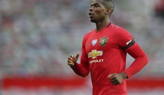 Manchester United's Paul Pogba runs during the English Premier League soccer match between Manchester United and West Ham at the Old Trafford stadium in Manchester, England, Wednesday, July 22, 2020. (Cath Ivill/Pool via AP)