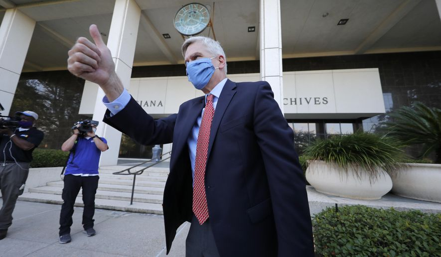 Sen. Bill Cassidy, R-La., acknowledges supporters as he arrives at the office of the Secretary of State to register as a candidate to run as an incumbent in Baton Rouge, La., Friday, July 24, 2020. (AP Photo/Gerald Herbert)