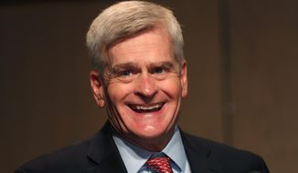 Sen. Bill Cassidy, R-La., delivers remarks to media after registering as a candidate to run as an incumbent in Baton Rouge, La., Friday, July 24, 2020. (AP Photo/Gerald Herbert)