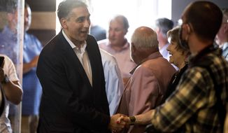 Republican U.S. Senate candidate Dr. Manny Sethi arrives for a town hall meeting with Sen. Ted Cruz, R-Texas, at Music City Baptist Church in Mt. Juliet, Tenn., Friday, July 24, 2020. (Andrew Nelles/The Tennessean via AP)