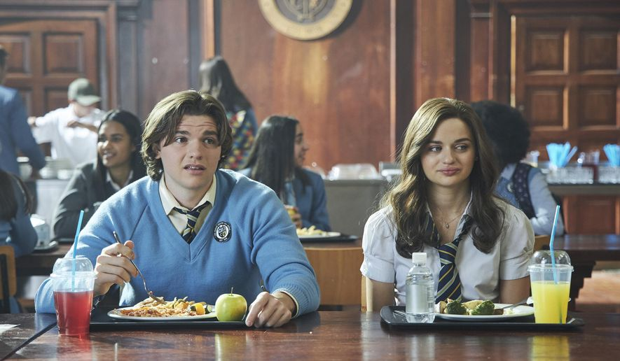 """This image released by Netflix shows Joel Courtney, left, and Joey King in a scene from """"The Kissing Booth 2."""" (Marcos Cruz/Netflix via AP)"""