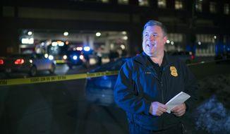 Minneapolis Police Public Information Officer John Elder briefs reporters on the shooting of two people on a bus, Feb. 6, 2020, in Minneapolis. The Minneapolis City Council voted Friday, July 24, 2020, to shift police media duties away from the Police Department to city communications staff, in what one of the proposal's authors called a small move designed to improve trust following the death of George Floyd. (Jeff Wheeler/Star Tribune via AP)