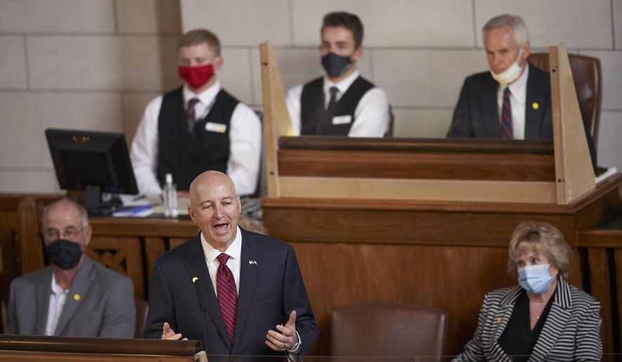 Nebraska Gov. Pete Ricketts addresses lawmakers in Lincoln, Neb., Friday, July 24, 2020. Gov. Ricketts touted Nebraska's pandemic response and rosier-than-expected revenue outlook in his address to the state Legislature on Friday. He also pushed for lawmakers to adopt his signature property tax relief package within the remaining 13 days of the session. (AP Photo/Nati Harnik)