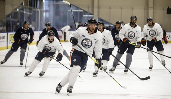 Edmonton Oilers' Connor McDavid (97) leads a skate during NHL hockey practice, Thursday, July 23, 2020, in Edmonton, Alberta. (Jason Franson/The Canadian Press via AP)