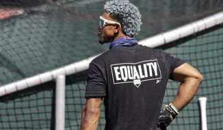 Cleveland Indians' Francisco Lindor watches during batting practice before a baseball game against the Kansas City Royals, Friday, July 24, 2020, in Cleveland. (AP Photo/Tony Dejak)