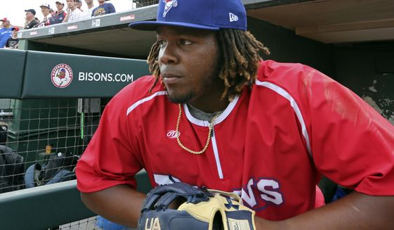 In this July 31, 2018, file photo, Toronto Blue Jays top prospect third baseman Vladimir Guerrero Jr. looks on before a minor league baseball with the Buffalo Bisons against the Lehigh Valley IronPigs in Buffalo, N.Y. The displaced Toronto Blue Jays will play in Buffalo, New York, this year amid the pandemic. An official familiar with the matter told The Associated Press on Friday that the Blue Jays will play at Sahlen Field. The official spoke on condition of anonymity as they were not authorized to speak publicly ahead of an announcement. (AP Photo/Jeffrey T. Barnes) ** FILE **