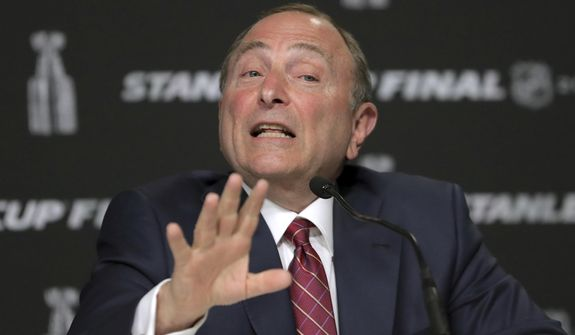 In this May 27, 2019, file photo, NHL Commissioner Gary Bettman speaks to the media before Game 1 of the NHL hockey Stanley Cup Final between the St. Louis Blues and the Boston Bruins in Boston. Bettman said getting to those quarantined bubbles and resuming play are just two more steps in the process with the goal of awarding the Stanley Cup in late September or early October. (AP Photo/Charles Krupa, File)  **FILE**