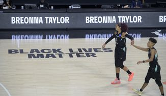 New York Liberty forward Amanda Zahui B and guard Layshia Clarendon, right, congratulate each other after a play during the second half of a WNBA basketball game against the Seattle Storm, Saturday, July 25, 2020, in Ellenton, Fla. (AP Photo/Phelan M. Ebenhack)