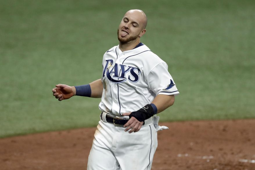 Tampa Bay Rays' Michael Brosseau reacts as he scores from first base on an RBI double by Ji-Man Choi off Toronto Blue Jays starting pitcher Matt Shoemaker during the sixth inning of a baseball game Saturday, July 25, 2020, in St. Petersburg, Fla. (AP Photo/Chris O'Meara)