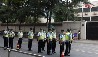 Chinese police officers form up in front of the United States Consulate in Chengdu in southwestern China's Sichuan province Saturday, July 25, 2020. China ordered the United States on Friday to close its consulate in the western city of Chengdu, ratcheting up a diplomatic conflict at a time when relations have sunk to their lowest level in decades. (AP Photo/Ng Han Guan)