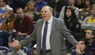 FILE - In this Jan. 6, 2019 file photo, Minnesota Timberwolves' head coach Tom Thibodeau calls out to his team during the second half of an NBA basketball game in Minneapolis.  A person with knowledge of the details says the New York Knicks are finishing a deal to make Thibodeau their coach. The person told The Associated Press, Saturday, July 25, 2020, that no contract has been signed but a deal is expected to be announced next week, ESPN first reported that the Knicks and Thibodeau were completing a five-year contract.(AP Photo/Stacy Bengs)
