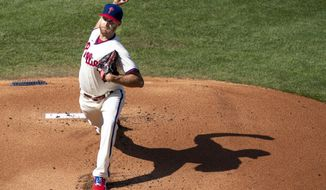 Philadelphia Phillies starting pitcher Zack Wheeler throws during the first inning of a baseball game against the Miami Marlins, Saturday, July 25, 2020, in Philadelphia. (AP Photo/Chris Szagola)