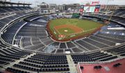 The New York Yankees and the Washington Nationals stand on the field before their opening day baseball game with no fans in the seats at Nationals Park, Thursday, July 23, 2020, in Washington. (AP Photo/Alex Brandon)  **FILE**