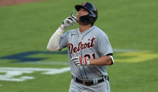 Detroit Tigers' JaCoby Jones reacts after hitting a two-run home run in the ninth inning during a baseball game against the Cincinnati Reds at Great American Ballpark in Cincinnati, Saturday, July 25, 2020. (AP Photo/Aaron Doster)