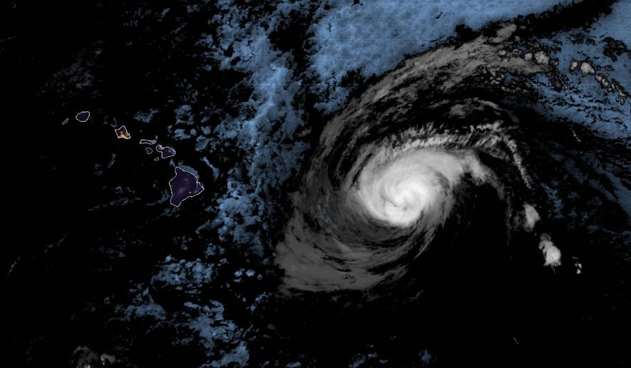 This 4:10 a.m. HST infrared satellite image made available by the National Oceanic and Atmospheric Administration shows Hurricane Douglas approximately 500 miles east of Hawaii. (NOAA via AP)