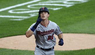 Minnesota Twins' Max Kepler celebrates his second home run off Chicago White Sox starting pitcher Lucas Giolito, during the second inning of a baseball game Friday, July 24, 2020, in Chicago. (AP Photo/Charles Rex Arbogast)
