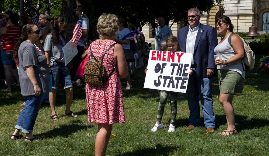 """Illinois State Rep. Darren Bailey, R-Xenia, poses for a picture during the """"Million Unmasked March"""" rally at the Illinois State Capitol, Saturday, July 25, 2020, in Springfield, Ill. The protesters gathered in front of the Abraham Lincoln Statue to voice their opposition to guidelines that children be required to wear face masks when they return to school during the COVID-19 pandemic. (Justin L. Fowler/The State Journal-Register via AP)"""