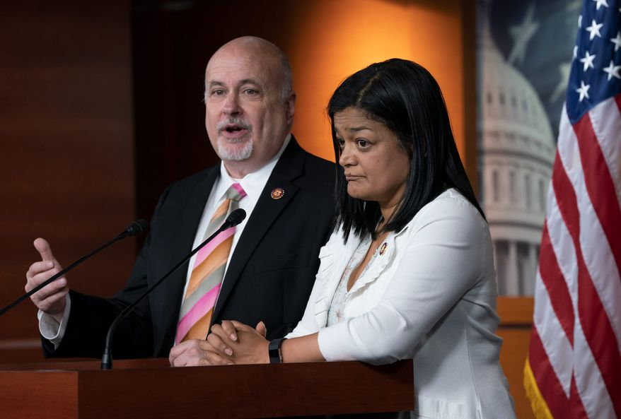 """Reps. Pramila Jayapal and Mark Pocan said unless there are new cuts to the Homeland Security spending bill, it would effectively """"sanction all the horrific violations of human rights and due process by ICE, CBP and other agencies."""" (Associated Press)"""
