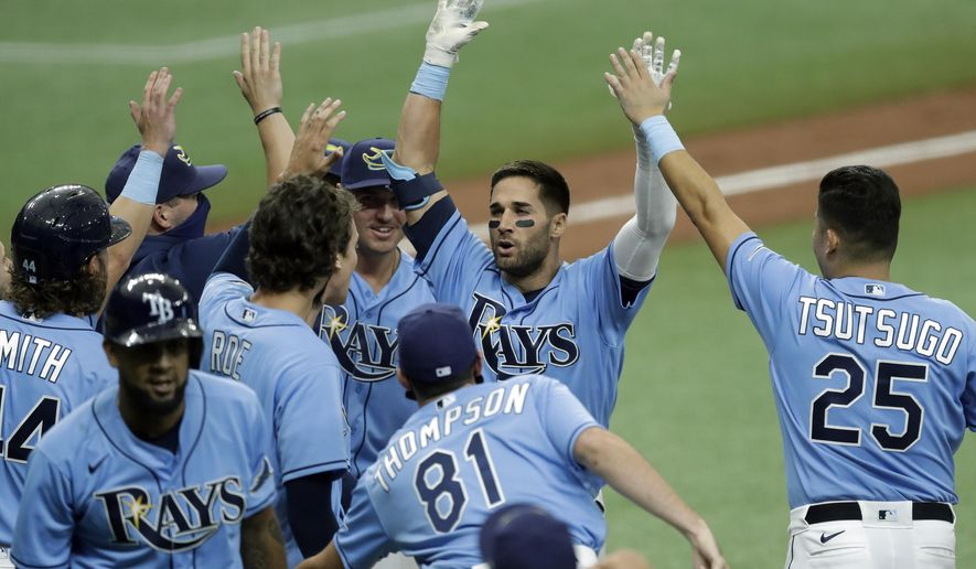 Tampa Bay Rays' Kevin Kiermaier, second from right, celebrates with teammates, including Yoshitomo Tsutsugo, of Japan, after his two-run walk-off double off Toronto Blue Jays relief pitcher Shun Yamaguchi during the 10th inning of a baseball game Sunday, July 26, 2020, in St. Petersburg, Fla. (AP Photo/Chris O'Meara)
