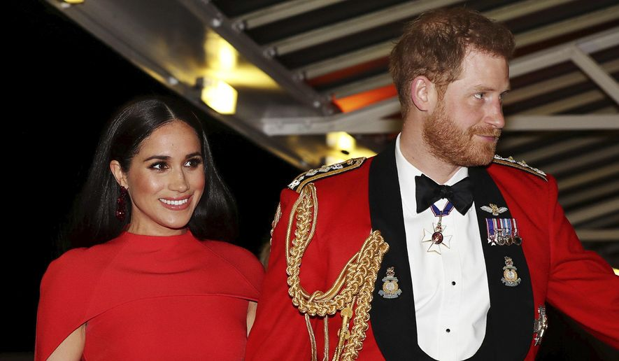 In this Saturday, March 7, 2020, file photo, Britain's Prince Harry and Meghan, duchess of Sussex arrive at the Royal Albert Hall in London, to attend the Mountbatten Festival of Music. (Simon Dawson/Pool via AP, File)