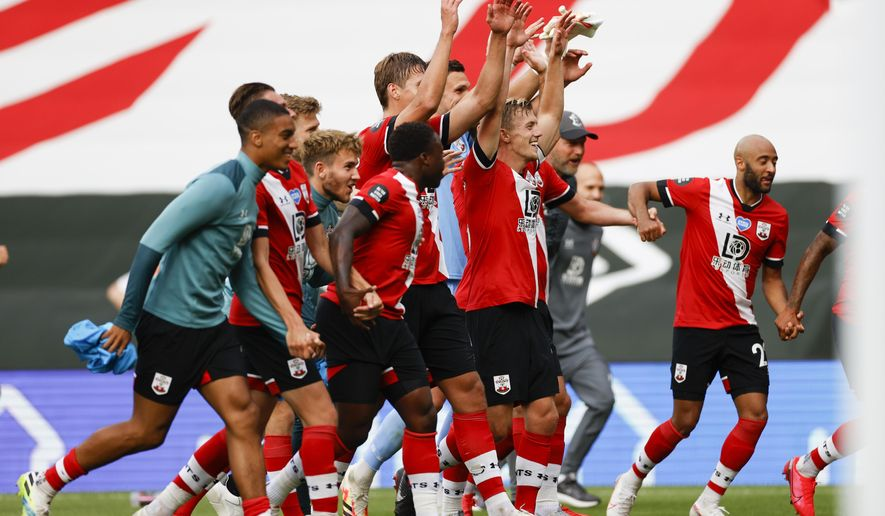The Southampton team celebrate after the English Premier League soccer match between Southampton and Sheffield United at St. Mary's Stadium in Southampton, England, Sunday, July 26, 2020. (Andrew Boyers/Pool via AP)