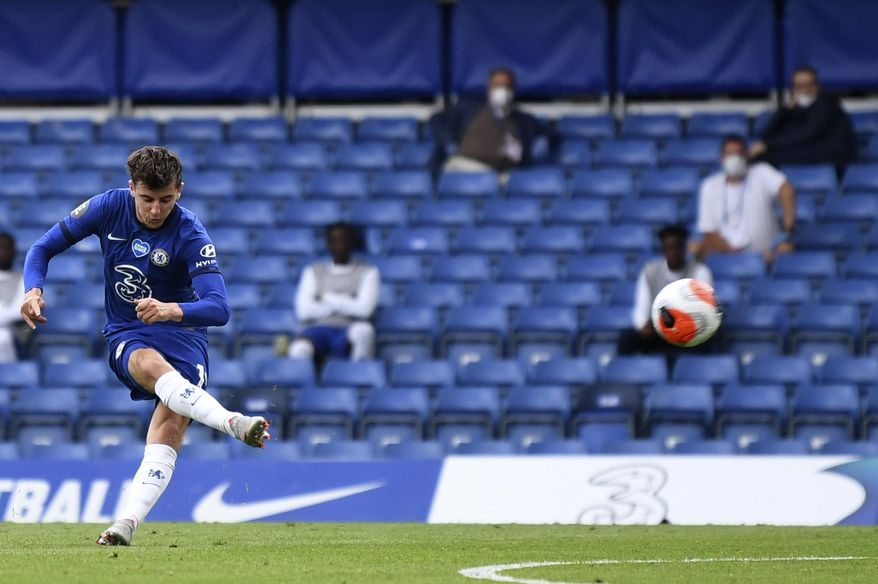Chelsea's Mason Mount shoots to score his sides first goal during the English Premier League soccer match between Chelsea and Wolverhampton Wanderers at Stamford Bridge, in London, Sunday July 26, 2020. (Daniel Leal-Olivas/Pool via AP)