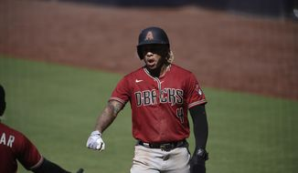 Arizona Diamondbacks' Ketel Marte is congratulated after scoring a run during the eighth inning of the team's baseball game against the San Diego Padres in San Diego, Sunday, July 26, 2020. The Diamondbacks won 4-3. (AP Photo/Kelvin Kuo)