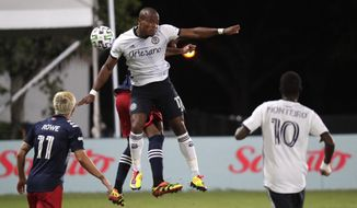 Philadelphia Union forward Sergio Santos (17) goes up for a header against New England Revolution defender Andrew Farrell during the first half of an MLS soccer match, Saturday, July 25, 2020, in Kissimmee, Fla. (AP Photo/John Raoux)