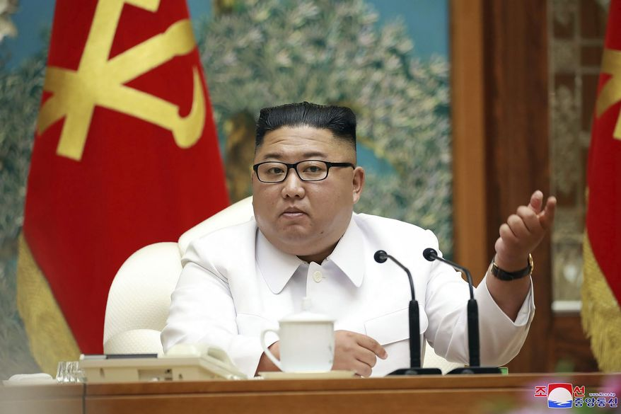 """In this photo provided by the North Korean government, North Korean leader Kim Jong Un attends an emergency Politburo meeting in Pyongyang, North Korea Saturday, July 25, 2020. Independent journalists were not given access to cover the event depicted in this image distributed by the North Korean government. The content of this image is as provided and cannot be independently verified. Korean language watermark on image as provided by source reads: """"KCNA"""" which is the abbreviation for Korean Central News Agency. (Korean Central News Agency/Korea News Service via AP)"""