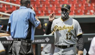 Pittsburgh Pirates manager Derek Shelton (17) argues with home plate umpire Jordan Baker during the third inning of a baseball game against the St. Louis Cardinals Sunday, July 26, 2020, in St. Louis. (AP Photo/Jeff Roberson)