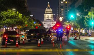 Austin police investigate a homicide shooting which occurred at a demonstration against police violence in downtown Austin, Saturday, July 25, 2020. (Stephen Spillman/Austin American-Statesman via AP)
