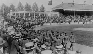 FILE - In this Aug. 26, 1920, file photo, the Olympics are held at the Antwerp Stadium, showing the U.S. contingent leading all the athletes in the procession around the field on, after which they proceeded to lead all competition in the athletic events. (AP Photo/File)