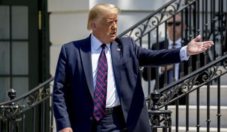 "President Donald Trump welcomes a group of supporters to come over to him as Terry Sharpe, known as the ""Walking Marine"" arrives at the White House in Washington, Monday, July 27, 2020. Sharpe has walked from Summerfield, N.C., to Washington to raise awareness of the current veteran suicide rate. (AP Photo/Andrew Harnik)"